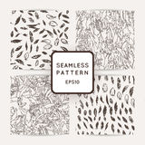 Set of ik feather seamless patterns. Hand drawn doodle vector backgrounds. Stock Image