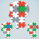 Set of images of a human face in the form a jigsaw puzzle. With colored parts Royalty Free Stock Photography