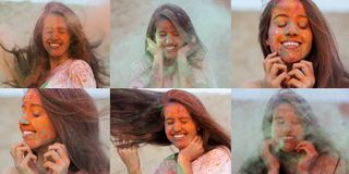 Set of images with merry brunette model posing with exploding orange and green Holi powder around her. Set of images with merry brunette woman posing with stock image