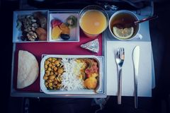 Set of inflight meal in a box. On the folding table in economy class. Feeding the passengers of Asian food on the plane in Kazakhstan. The journey tour, on the royalty free stock photos