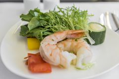 Set inflight meal shrimp on a tray, on a white table stock photography