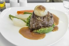 Free Set Inflight Meal Steak On A Tray, On A White Table Stock Photo - 116990890