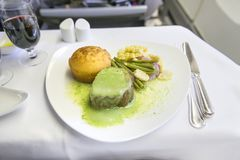 Set inflight meal steak on a tray, on a white table stock photos