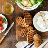 Bruschetta with feta cheese, tomatoes, avocado. Ingredients for Stock Images