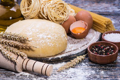 Set of ingredients for cooking pasta Stock Photos
