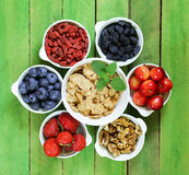 Set of ingredients for a healthy food breakfast - muesli, fresh and dried fruit, nuts, goji Stock Images