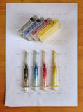 Set of Ink cartridges and dirty refill syringes Royalty Free Stock Photos