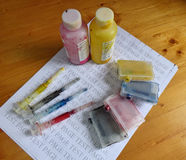 Set of Ink cartridges, refill paints and dirty syringes Royalty Free Stock Image