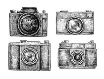 Set of ink hand drawn vintage cameras sketches Royalty Free Stock Photo
