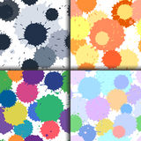 Set of ink and paint spots seamless patterns, vector splattered blots background Stock Photos