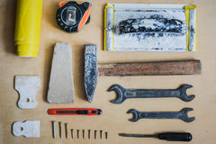 Set of instruments for repairing on wood top view Stock Photography