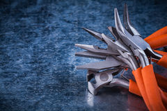 Set of insulated electric gripping tongs nippers copy space imag Royalty Free Stock Photo