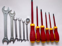 A set of insulated screwdrivers on wooden background Royalty Free Stock Images