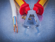 Set of insulated strippers electric wires on metallic background Royalty Free Stock Photography