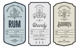 Set of intage bottle label design with ethnic elements in thin line style. Set of vintage bottle label design with ethnic elements in thin line style. Alcohol Stock Images