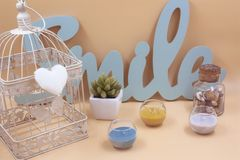 Set of interior decoration with several different objects, cage, candles plants and letters stock images