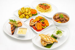 Set of international dishes arranged for catering. Studio shot Royalty Free Stock Photos