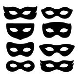 Set of isolated carnival masks. Festive masks silhouette in black on a white background Royalty Free Stock Photography