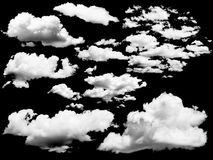 Set of isolated clouds over black. Stock Photo