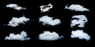 Set of isolated clouds over black royalty free stock image