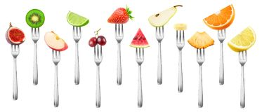 Set of isolated cut fruits on a fork Stock Images