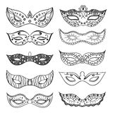 Set of isolated festive black hand drawn mask silhouette on the white background.  Mardi Gras masks. Royalty Free Stock Photos