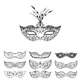 Set of isolated festive black hand drawn mask silhouette on the white background. Mardi Gras masks. Stock Photography