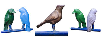 Set of isolated metal birds on perches Royalty Free Stock Images