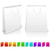Set of isolated paper bags on white background. With different color variations. Vector Stock Image