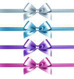 Set of isolated pink, white and blue photorealistic silk bows Stock Photos