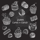 Set of isolated sweet cakes and sweets on dark background Stock Image