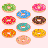 Set of isometric donuts. Set of cute colorful isometric donuts isolated on light pink background royalty free illustration