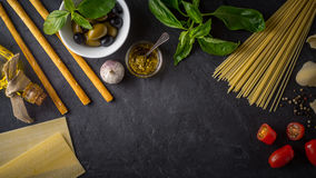 Set of Italian food on the black stone table wide screen Royalty Free Stock Image