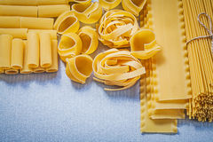 Set of Italian raw pasta on blue background food and drink conce Royalty Free Stock Images