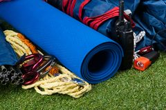 Set of items for outdoor activities, radio, tent, rope. green lawn background. stock image