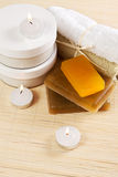 Set of items for spa. Treatments: soaps, towels and moisturizer Royalty Free Stock Image
