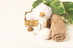 A set of items for the spa procedures. Bath salt, towel, sponge on the background plant. Beauty and body care concept. stock photos