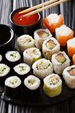 Set of Japanese rolls in the assortment are served with sauces c Stock Photography