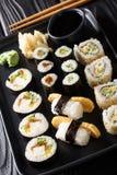 Set of Japanese rolls sushi Hosomaki, Uramaki, Maki, Nigiri, Tamagoyaki served with ginger, wasabi and soy sauce close-up. Set of Japanese rolls sushi Hosomaki royalty free stock image