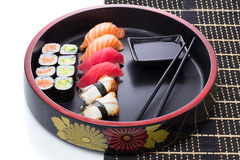 Set of japanese sushi with chopsticks and soy sause over white Royalty Free Stock Images