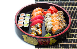 Set of japanese sushi with chopsticks and soy sause over white Stock Images