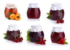 Set of jars with berry jam isolated on white Stock Photos