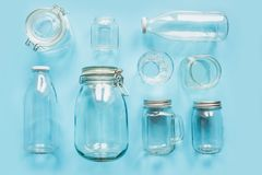 Set of jars on blue background for zero waste storage and shopping. View from above stock images