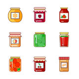 Set of jars with honey, jam and vegetables Stock Photography