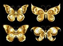 Set of jewelry butterflies. Set of artistic, jewelry, gold butterflies on a black background. Gold Butterflies Stock Photo