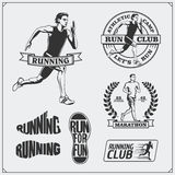 Set of jogging and running club labels, emblems, badges and design elements. Running shoes icons and silhouettes of runners. Black and white Royalty Free Stock Photography