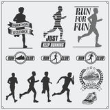 Set of jogging and running club labels, emblems and design elements. Silhouettes of runners. Royalty Free Stock Photos