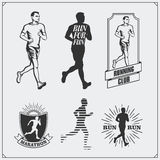 Set of jogging and running club labels, emblems and design elements. Silhouettes of runners. Royalty Free Stock Image