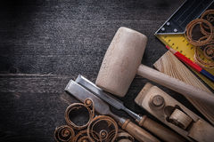 Set of joiner tools on wooden board construction Royalty Free Stock Photo