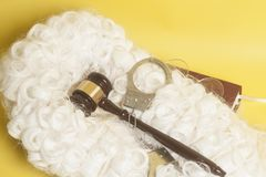 Set for judge:judge wig,handclufs, judge gavel,book end eyeglass. Es stock photos
